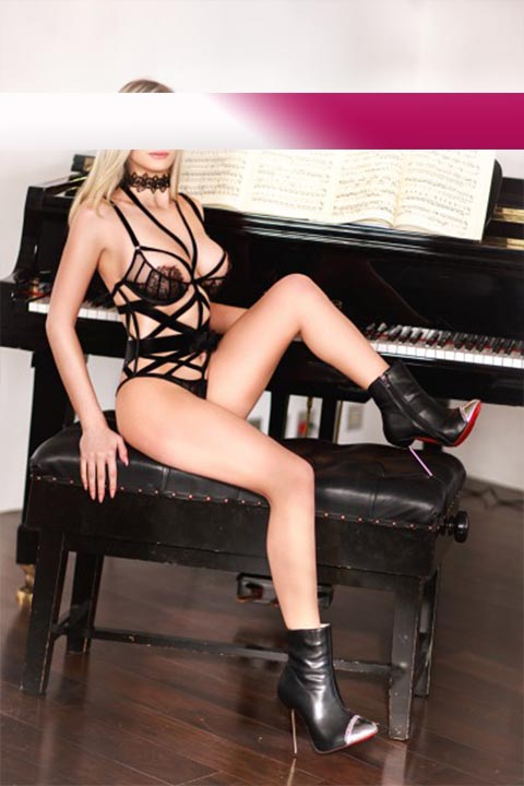 Claudia from Nuernberg with high Heels at a Piano